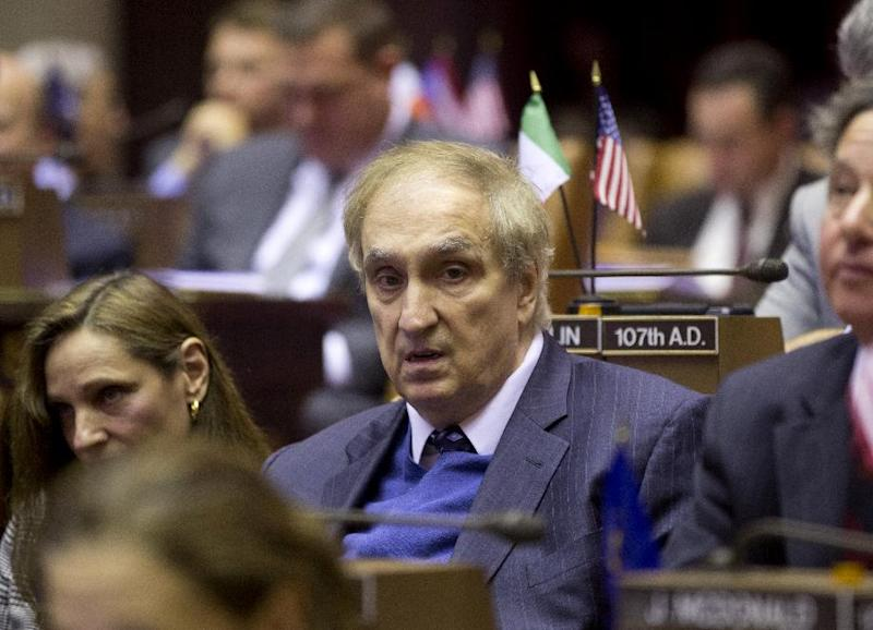 """This Jan. 14, 2013 photo, Assemblyman Vito Lopez sits during a session at the Capitol in Albany, N.Y.   A New York prosecutor decided Wednesday, May 15, 2013,  that Lopez's behavior toward women on his staff was """"alarming"""" rather than criminal harassment, but lambasted Albany leaders as too interested in protecting themselves and said their secretive, back-door behavior encouraged his inappropriate conduct. Staten Island District Attorney Daniel Donovan said his office did more than 50 interviews but there was no basis to conclude a chargeable offense was committed. He also found no criminal activity in the secret settling and confidentiality agreements of some of the complaints made against Lopez, but sharply criticized Albany's handling of it.  (AP Photo/Mike Groll)"""