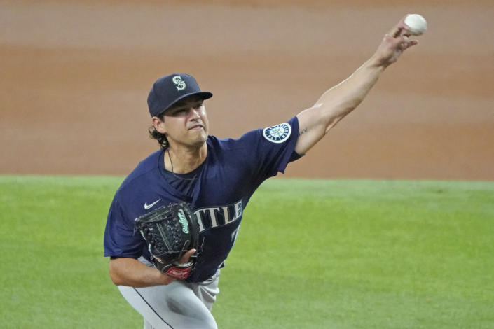 Seattle Mariners starting pitcher Marco Gonzales throws against the Texas Rangers in the first inning of a baseball game Sunday, Aug. 1, 2021, in Arlington, Texas. (AP Photo/Louis DeLuca)
