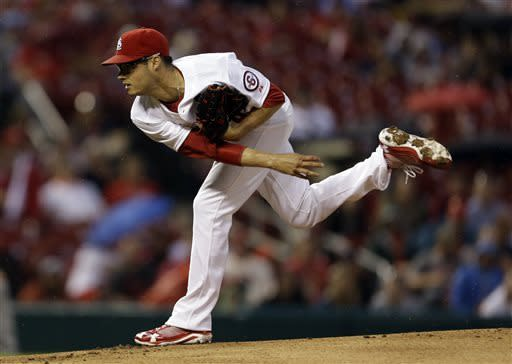 St. Louis Cardinals starting pitcher Joe Kelly throws during the first inning of a baseball game against the Arizona Diamondbacks, Wednesday, June 5, 2013, in St. Louis. (AP Photo/Jeff Roberson)