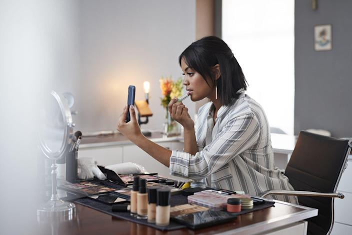 woman applying neutral color makeup