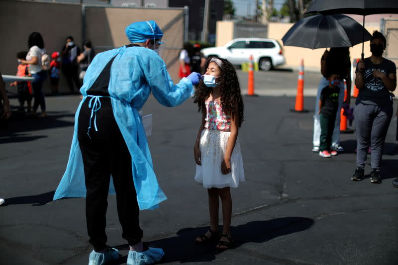 FILE PHOTO: Alisson Argueta, 8, is given a COVID-19 test at a back-to-school clinic in Los Angeles