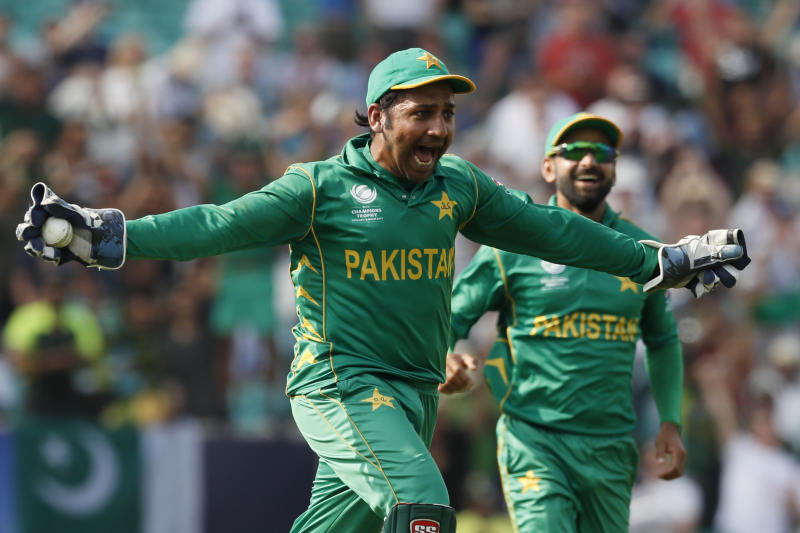 FILE - In this Sunday June 18, 2017 file photo, Pakistan's captain Sarfraz Ahmed celebrates after he caught India's Jasprit Bumrah to take India last wicket and win the ICC Champions Trophy final at The Oval in London. The 2019 Cricket World Cup starts in England on May 31. (AP Photo/Kirsty Wigglesworth, File)