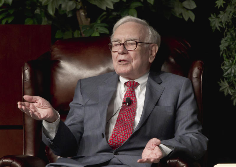 FILE - In this Nov. 14, 2011 photo, Billionaire investor Warren Buffett speaks in Omaha, Neb., Monday, Nov. 14, 2011 at an event to raise money for the Girls Inc. charity organization.  Buffett wants Berkshire Hathaway shareholders to know that the company has someone in mind to replace him eventually, but he's emphasizing that he has no plans to leave. Buffett offered a couple new details about Berkshire's succession planning in his annual shareholder letter Saturday, Feb. 25, 2012. Investors have long worried about who will replace Berkshire's 81-year-old CEO.  (AP Photo/Nati Harnik)