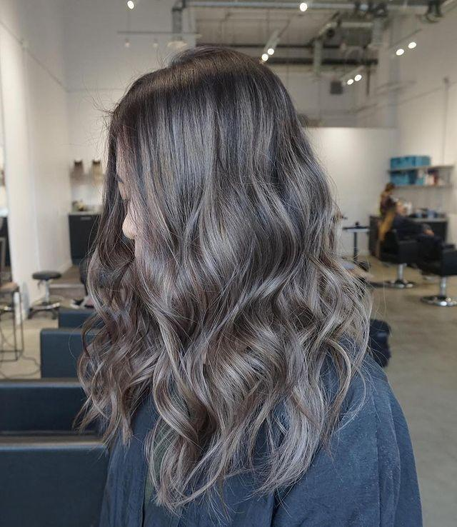 """<p>I love how this ash-brown hair color leans a bit more gray than some of the other options. Go for this look if you want something <strong>extra cool-toned and <a href=""""https://www.cosmopolitan.com/style-beauty/beauty/g26632550/ash-blonde-hair-color-ideas/"""" rel=""""nofollow noopener"""" target=""""_blank"""" data-ylk=""""slk:ashy"""" class=""""link rapid-noclick-resp"""">ashy</a>.</strong></p><p><a href=""""https://www.instagram.com/p/Bw-3I6RlGyv/"""" rel=""""nofollow noopener"""" target=""""_blank"""" data-ylk=""""slk:See the original post on Instagram"""" class=""""link rapid-noclick-resp"""">See the original post on Instagram</a></p>"""