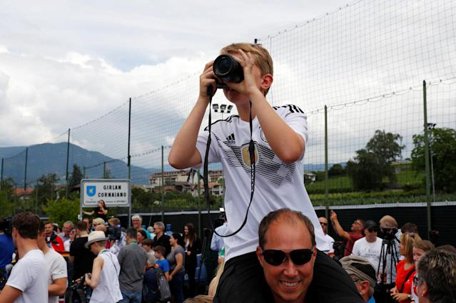 Soccer Football - FIFA World Cup - Germany Training - Eppan, Italy - May 23, 2018 German fans wait for the players to arrive REUTERS/Leonhard Foeger
