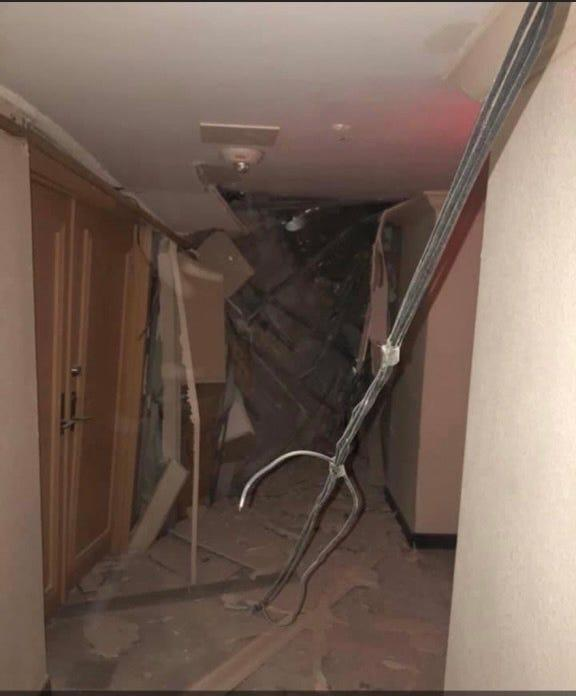 A picture of the collapsed hallway in the Champlain Tower building.