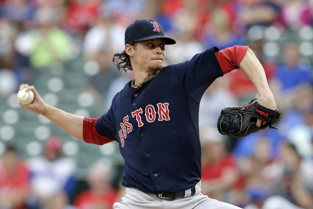 Boston Red Sox starting pitcher Clay Buchholz works against the Texas Rangers in the first inning of a baseball game, Friday, May 9, 2014, in Arlington, Texas. (AP Photo/Tony Gutierrez)