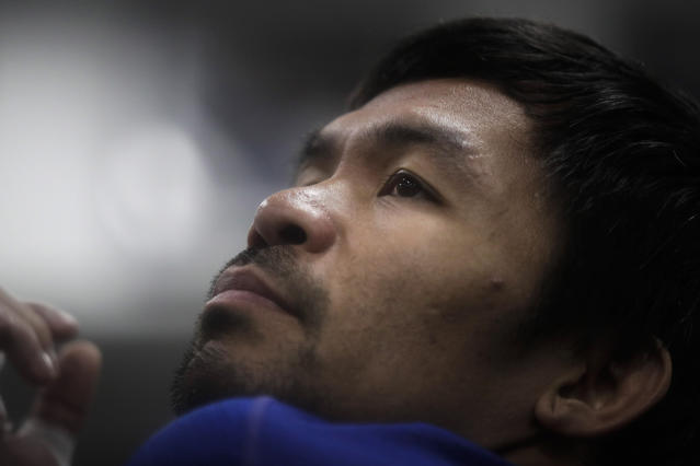 Boxer Manny Pacquiao stretches before his workout at the Wild Card Boxing Club Monday, Jan. 14, 2019, in Los Angeles. The Filipino legend is in the winter of his career, gearing up for what could be one big last fight. Saturday's bout versus Broner isn't it, but Pacquiao trains with the knowledge that a second megafight against Floyd Mayweather could possibly be just months away if all goes well. (AP Photo/Jae C. Hong)