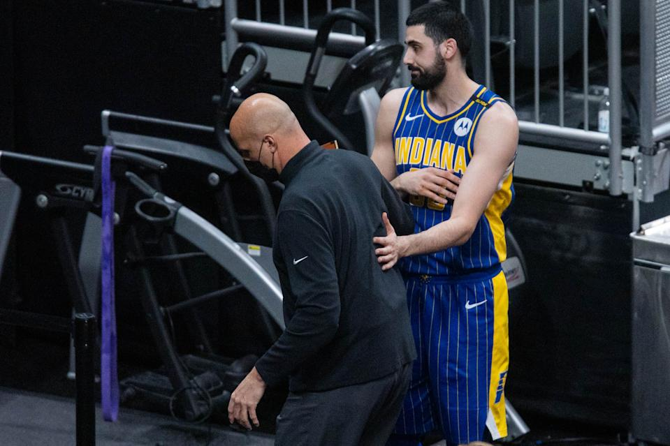 Indiana Pacers center Goga Bitadze tries to talk to assistant coach Greg Foster