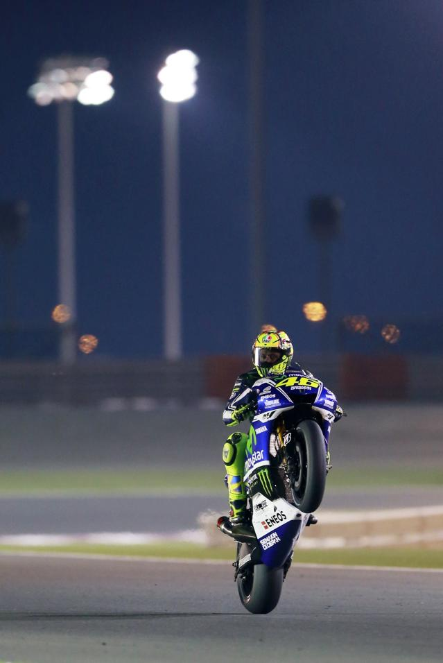 Yamaha MotoGP rider Valentino Rossi of Italy rides his bike during a free practice session at the MotoGP World Championship at the Losail International circuit in Doha March 20, 2014. REUTERS/Mohammed Dabbous (QATAR - Tags: SPORT MOTORSPORT)