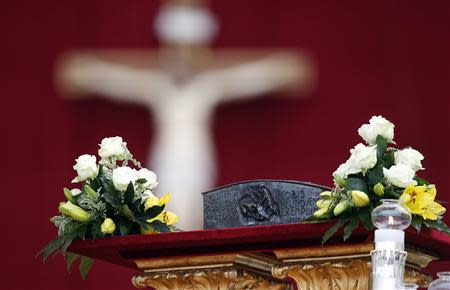 The relics of the Apostle Peter are pictured on the altar before Pope Francis' mass at St. Peter's Square at the Vatican November 24, 2013. REUTERS/Stefano Rellandini