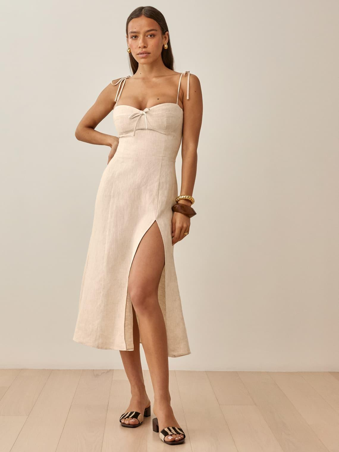 The Joyce Linen Dress comes in other neutral colours, as well as prints, but it's selling out fast.  (Reformation)