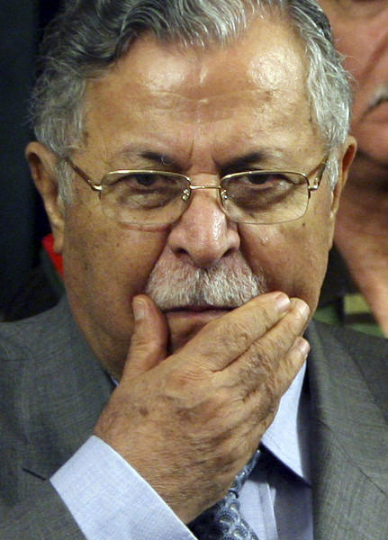 FILE - In this Wednesday, Aug. 2, 2006 file photo, Iraq's President Jalal Talabani pauses after announcing new security plans in Baghdad, Iraq. A doctor who oversees Talabani's medical care when he is in Iraq, says the president who is currently in Germany for treatment, is able to speak with and understand those around him more than two months after suffering a stroke. (AP Photo/ Khalid Mohammed, File)