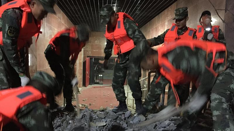 Rescuers are searching for survivors after a quake in Sichuan province killed at least 13.