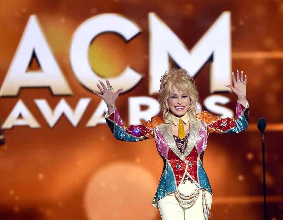 <p>Fast-forward to 2016, Dolly accepts an award named in memory of her late friend Tex Ritter at the CMAS for her NBC movie, <em>Dolly Parton's Coat of Many Colors.</em></p>