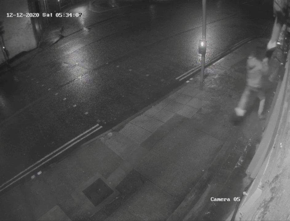 Shocking CCTV footage showed a meanspirited thief nicking Santa's boots from a homemade effigy outside a pub