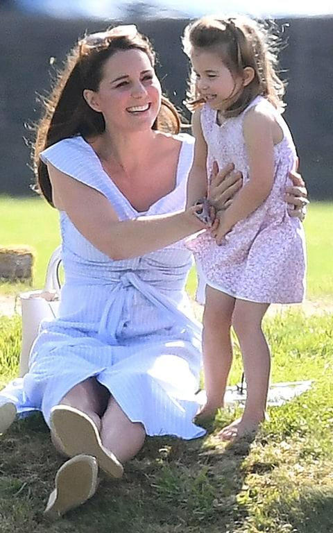 Family day out: Prince William was playing at the Beaufort Polo Club while his family looked on - Credit: James Whatling