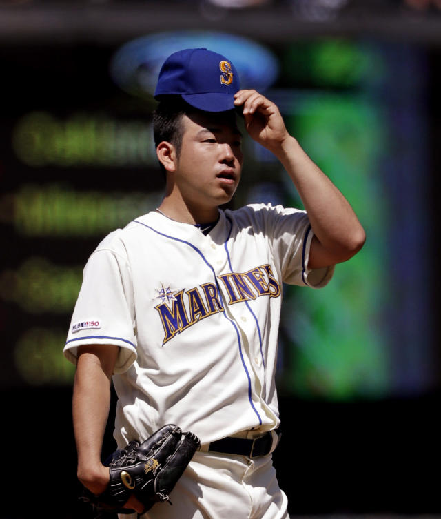 Seattle Mariners starting pitcher Yusei Kikuchi pauses after giving up a run to the Los Angeles Angels in the fourth inning of a baseball game Sunday, July 21, 2019, in Seattle. (AP Photo/Elaine Thompson)