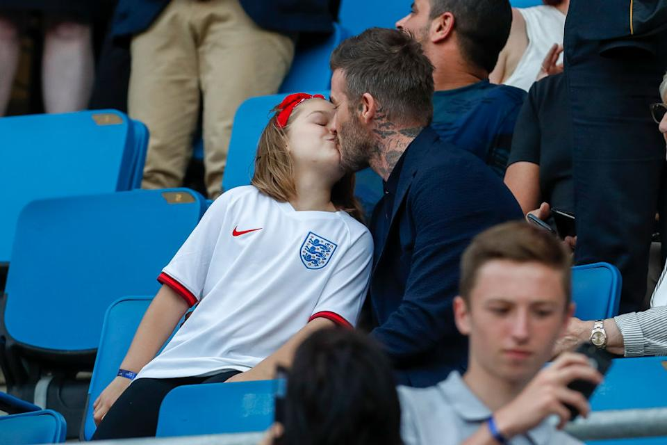 It isn't the first time David Beckham has been photographed kissing Harper on the lips, pictured here in June 2019. (Getty Images)