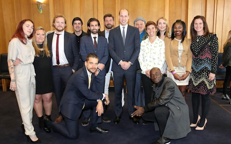 The Duke of Cambridge poses with Mind over Marathon runners - Credit: Getty