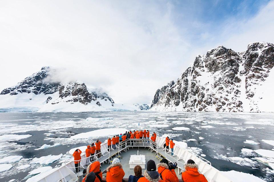 A cruise ship approaches the Lemaire Channel in the Antarctic Peninsula.