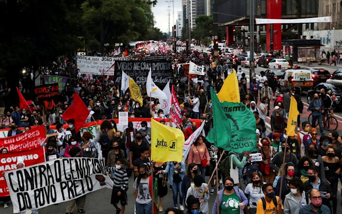 Demonstrators march in Sao Paulo during the National Black Consciousness Day - REUTERS