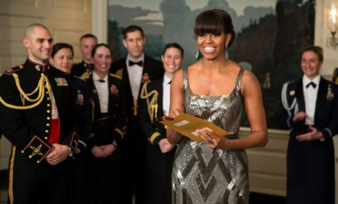 The first lady opens the envelope holding the name of the Best Picture winner.