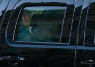 US President Donald Trump watches from the motorcade as he returns to the White House in Washington, DC, after playing golf on November 7, 2020. - Joyous celebrations erupted in Washington on Saturday after Joe Biden was declared winner of the US presidency, as several people poured into the streets of the US capital -- some of them chanting, cheering and singing in front of the White House. (Photo by ALEX EDELMAN / AFP) (Photo by ALEX EDELMAN/AFP via Getty Images)