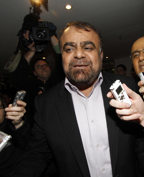Iran's Minister of Petroleum Rostam Ghasemi talks to journalists as he arrives at a hotel for a meeting of the Organization of the Petroleum Exporting countries, OPEC, in Vienna, Austria, Tuesday, Dec. 11, 2012. (AP Photo/Ronald Zak)