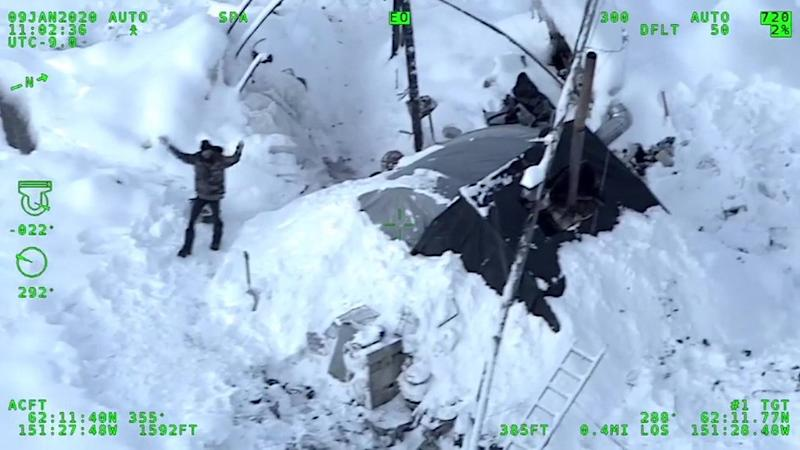 Tyson Steele waving at a helicopter for rescue