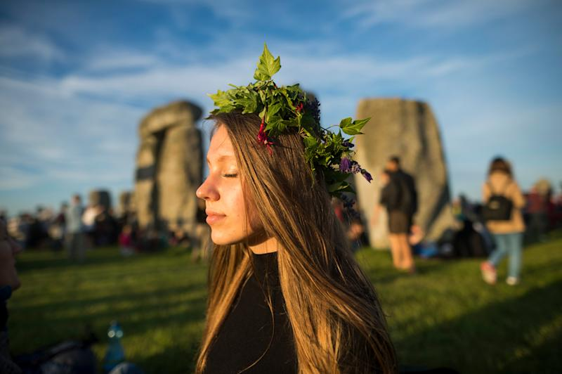 Celebrating the solstice at Stonehenge - Credit: PAUL GROVER