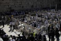 Ultra-orthodox Jewish men pray during the Jewish holiday of Passover at the Western Wall, the holiest site where Jews can pray in the Old City of Jerusalem, Monday, March 29, 2021. The Cohanim believed to be descendants of priests who served God in the Jewish Temple before it was destroyed, perform a blessing ceremony of the Jewish people three times a year during the holidays of Sukkot, Passover, and Shavuot. (AP Photo/Sebastian Scheiner)