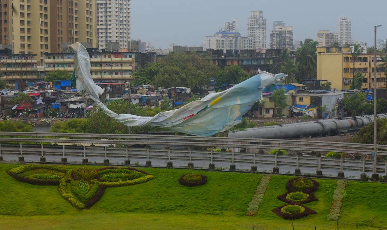 MUMBAI, INDIA - JUNE 3: Billboard at Mahim causway was teared away by stromy winds lose parts of the flex flying on the road on June 3, 2020 in Mumbai, India. Alibaug witnessed wind speeds of up to 120 kilometres per hour. Although the cyclone made the landfall just 95 kilometres from Mumbai, the Maharashtra capital largely escaped its wrath. (Photo by Vijayanand Gupta/Hindustan Times via Getty Images)
