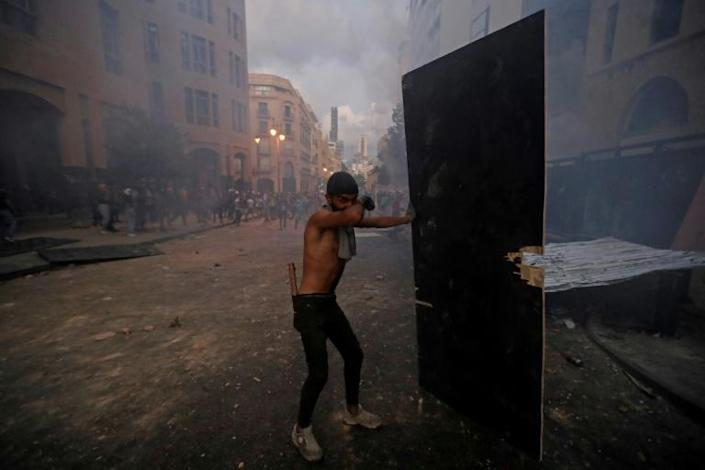 Police later fired tear gas in an attempt to disperse protesters who hurled stones and let off fireworks near a street leading to parliament