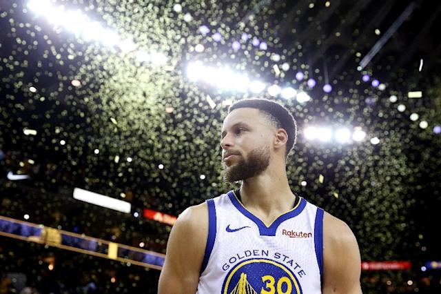 Star power: Stephen Curry departs the court after scoring 36 points in the Warriors 116-94 win over the Portland Trail Blazers in game one of the NBA Western Conference Finals (AFP Photo/EZRA SHAW)