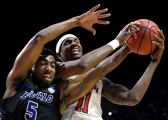<p>Tariq Owens #11 of the Texas Tech Red Raiders grabs the rebound away from CJ Massinburg #5 of the Buffalo Bulls during the second half of the second round game of the 2019 NCAA Men's Basketball Tournament at BOK Center on March 24, 2019 in Tulsa, Oklahoma. (Photo by Harry How/Getty Images) </p>