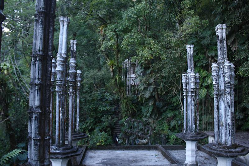 This Jan. 31, 2014 photo shows tall bamboo-shaped columns in Las Pozas, a dreamy, little-known garden of surreal art, where sculptures evoke the ruins of ancient Greece but are overrun by exotic plants in Mexico's northeast jungle. Las Pozas is located on a 100-acre (40-hectare) hillside where the Sierra Madre mountains and coastal plains of the northeast state of San Luis Potosi meet. (AP Photo/Teresa de Miguel Escribano)