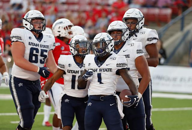 Utah State running back Gerold Bright celebrates a touchdown with his teammates during the first half of an NCAA college football game against Fresno State in Fresno, Calif., Saturday, Nov. 9, 2019. (AP Photo/Gary Kazanjian)
