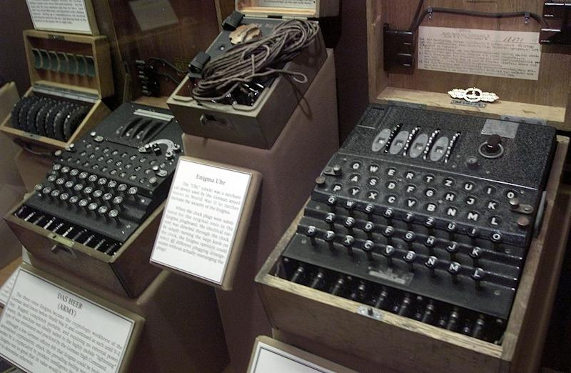 FILE -- This is a Tuesday, June 25, 2002 file picture, showing a four-rotor Enigma machine, right, once used by the crews of German U-boats in World War II to send coded messages, which British World War II code-breaker mathematician Alan Turing, was instrumental in breaking, and which is widely thought to have been a turning point in the war. Homosexuality was illegal in Britain at that time and Alan Turing received medical treatment following his conviction for what was considered indecency, however British Prime Minister Gordon Brown has apologized for the