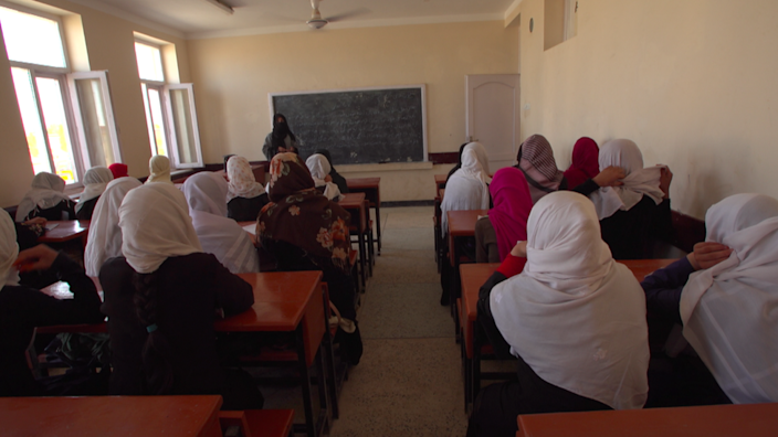 Girls photographed in a local classroom managed by the Taliban