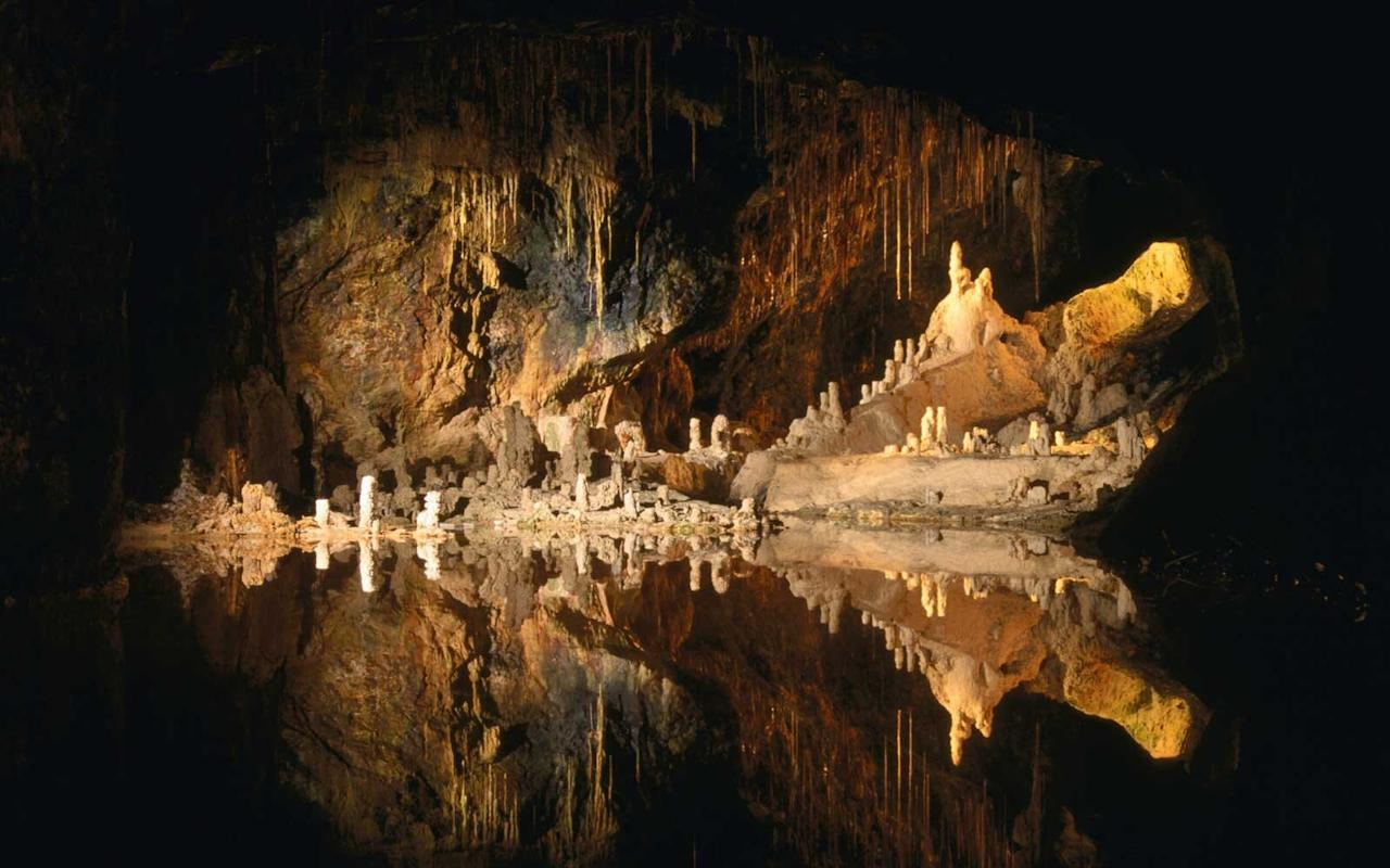 "<p>Near the border of the German state of Thuringia, the <a href=""http://en.feengrotten.de/"">Saalfeld Fairy Grottoes</a> (or <i>Feengrotten</i>) used to be mined for shale and were largely forgotten between the 19th and 20th centuries. In 1910 they were rediscovered, but far from being a derelict old cave system, the Fairy Grottoes had developed stunning multicolored mineral deposits. Today, one of the caverns is illuminated with colorful lights to further enhance the mineral deposits, and the <i>Feenweltchen </i>village above the caves is a family-friendly fantasy experience you won't want to miss. Top off the day with the interactive museum, the Grottoneum, where you can touch, smell, and even taste different exhibits.</p>"