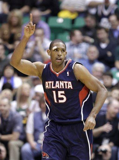 Atlanta Hawks' Al Horford points gestures after scoring in the second half during an NBA basketball game against the Utah Jazz on Wednesday, Feb. 27, 2013, in Salt Lake City. The Hawks defeated the Jazz 102-91. (AP Photo/Rick Bowmer)