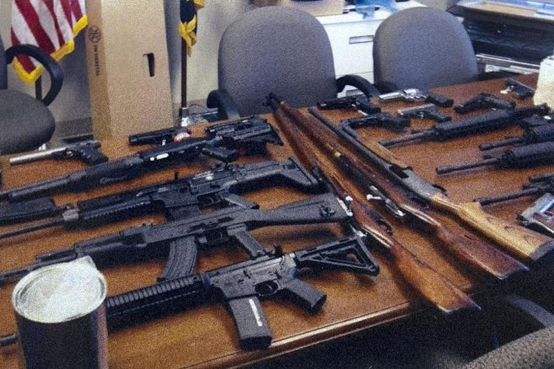 "This undated handout photo provided by the Prince George's, Md. County Police shows weapons found in the possession of a suspect who they say was plotting a shooting in his workplace. Police in Maryland say a man who called himself ""a joker"" and threatened to shoot up his workplace was in the process of being fired. Police say the 28-year-old man was taken into custody Friday morning. Investigators said he was wearing a T-shirt that said ""Guns don't kill people. I do."" He was taken into custody for an emergency mental health evaluation and charges are pending. (AP Photo/Prince George's County Police)"