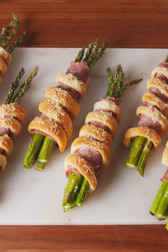 """<p>The perfect spring party food!</p><p>Get the recipe from <a rel=""""nofollow"""" href=""""https://www.delish.com/cooking/recipe-ideas/a19550286/ham-asparagus-bundles-recipe/"""">Delish</a>.</p><p><a rel=""""nofollow"""" href=""""https://www.amazon.com/Farberware-Classic-Wood-Rolling-Pin/dp/B005D6GFFA"""">BUY NOW</a> Classic Wooden Rolling Pin, 6;18<br></p>"""
