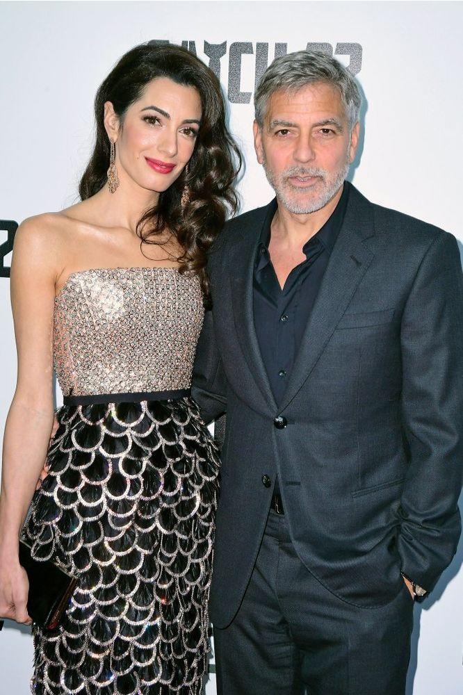 George and Amal Clooney | Ian West/PA Images via Getty