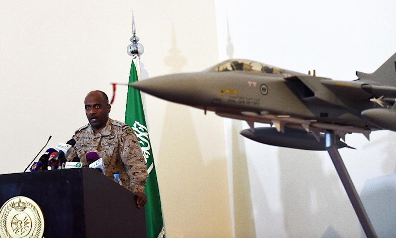 Saudi Brigadier General Ahmed Asiri, spokesman of the Saudi-led coalition forces, speaks to the media next to a replica of a Tornado fighter jet, at the Riyadh airbase in the Saudi capital on March 26, 2014 (AFP Photo/Fayez Nureldine)