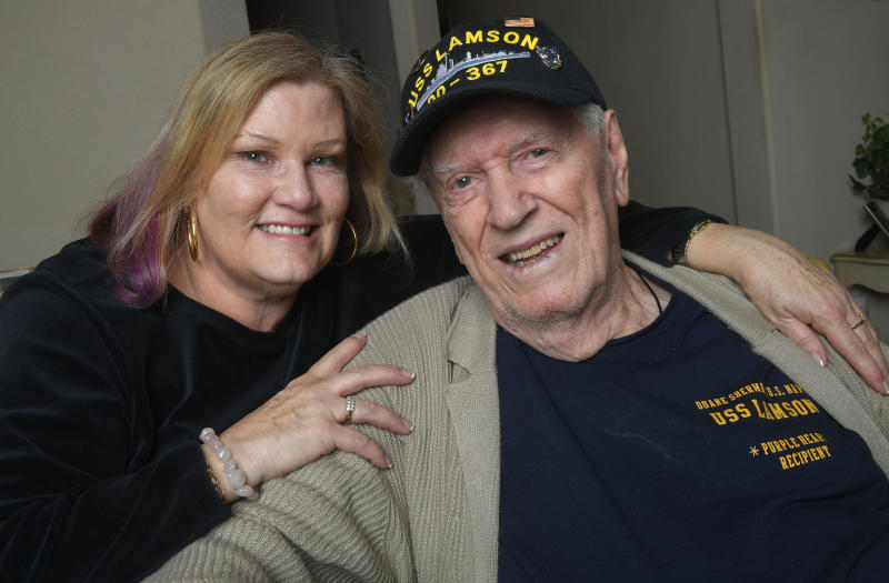 In this Tuesday, Jan. 8, 2019 photo Sue Morse and her dad Duane Sherman, 96, pose for a photo at their home in Fullerton, Calif. Sue posted on social media asking friends to send him a birthday card to cheer him up. It went viral and they've received over 50,000 cards and gifts so far. (Kevin Sullivan/The Orange County Register via AP)