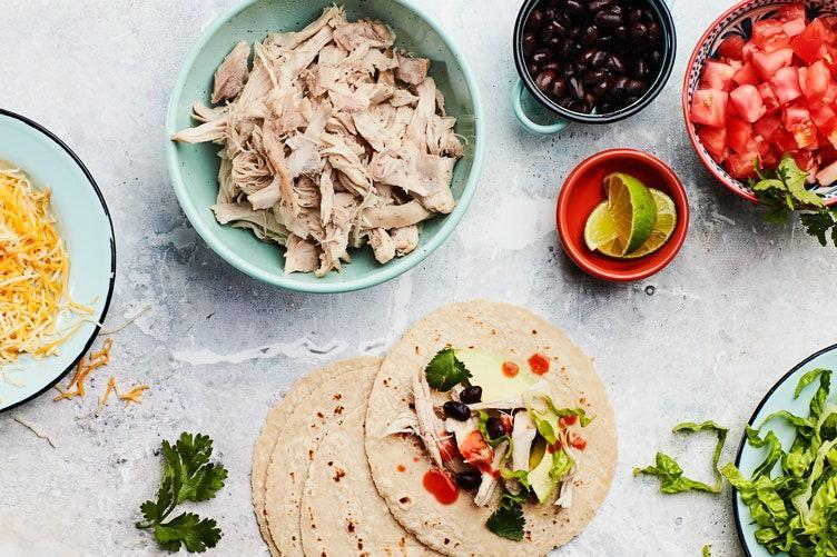 """Freeze smaller portions of this versatile, flavorful shredded chicken and you'll be so glad you did. It's the perfect base to build any meal—tacos, fried rice, hearty soups, pastas, barbecue chicken sandwiches, or anything else your heart desires. <a href=""""https://www.epicurious.com/recipes/food/views/slow-cooker-shredded-chicken?mbid=synd_yahoo_rss"""" rel=""""nofollow noopener"""" target=""""_blank"""" data-ylk=""""slk:See recipe."""" class=""""link rapid-noclick-resp"""">See recipe.</a>"""