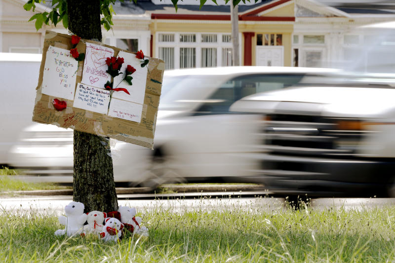 A makeshift memorial is shown near the location where a mother and three young sons were struck and killed while trying to cross a busy highway after dark, Wednesday, July 17, 2013, in Philadelphia. A fourth son was injured in the crash Tuesday night on Roosevelt Boulevard, a major artery that divides neighborhoods in north and northeast Philadelphia. (AP Photo/Matt Rourke)