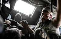 US-backed fighters elated over front-row seats to Raqa fall